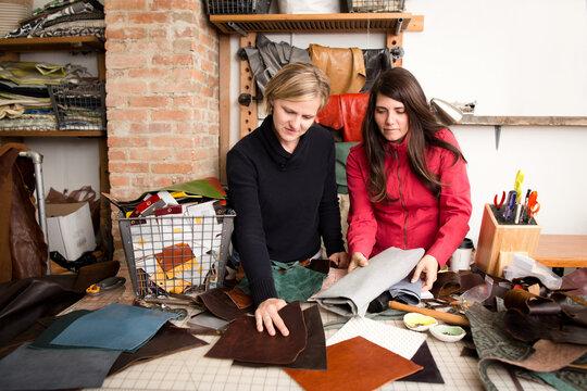 Women examine leather swatches