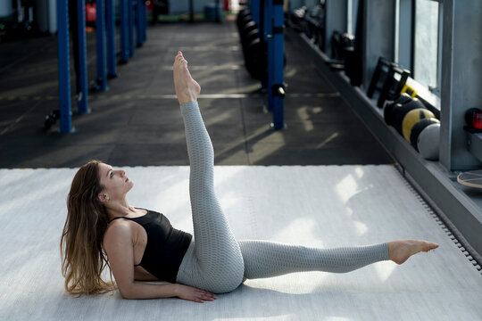 Gymnast doing stretching in the gym