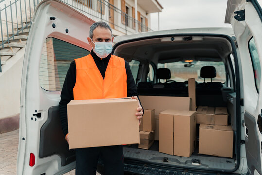 Portrait of delivery man prepared to deliver packages.