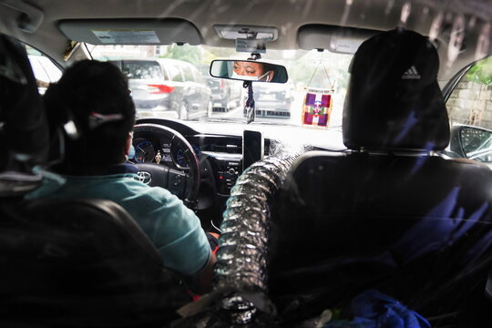 Uber driver is separated with a plastic partition while driving in New York City