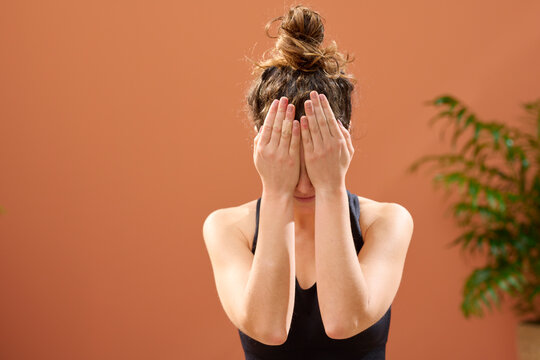 Woman doing yoga for eyes.