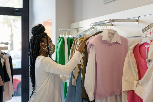 Woman during shopping in a dress shop