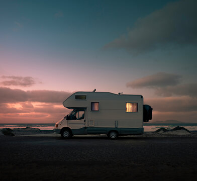 Mobile home with light at sunset