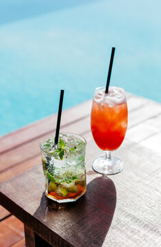 Summer poolside mojito and tequila sunrise cocktails