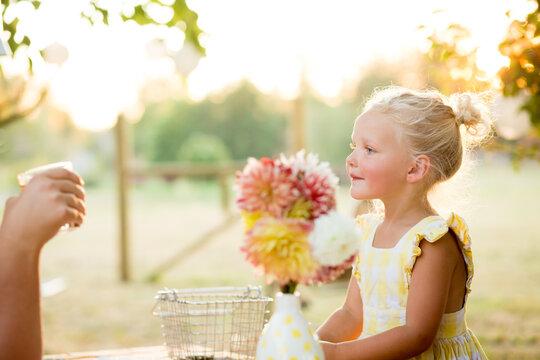 Profile of beautiful blonde girl in sunlight
