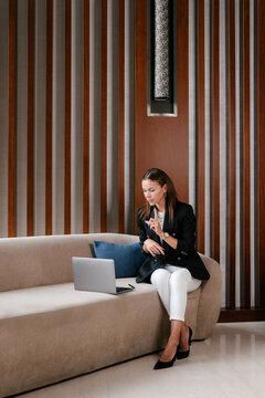 Businesswoman having nonverbal conversation during online meeting