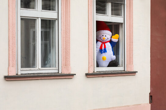 Snowman is spending Christmas and New Years holidays in isolation and quarantine caused by pandemic