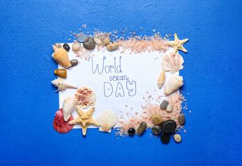 Fototapeta Paper sheet with text WORLD OCEAN DAY and sea shells on color background obraz
