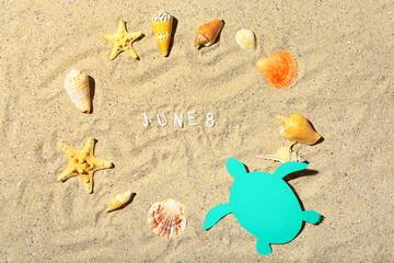 Fototapeta Date of World Ocean Day with sea shells on beach sand obraz