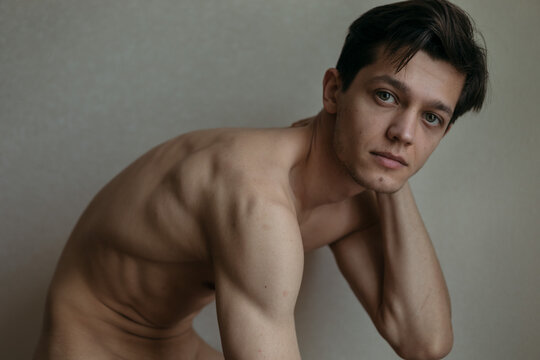 handsome man without clothes to the waist posing for the camera