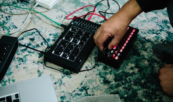 hand adjusting a sequencer