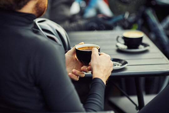 Male Road Cyclist stops for coffee mid ride