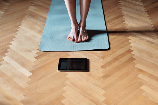 Anonymous yogi at home on the mat