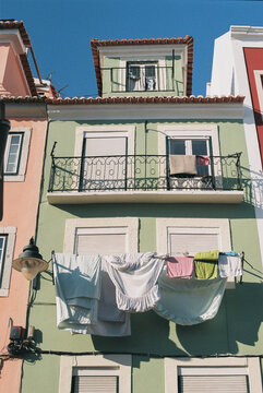 Green house in Lisbon with drying laundry