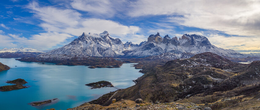 Winter in Patagonia: aerial view of a landscape with the lake Lago Pahoe and the snow covered Paine mountain range
