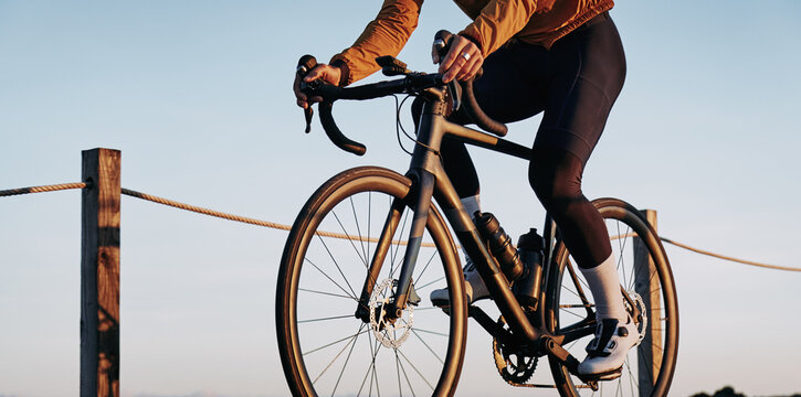 Male cyclist riding by the ocean