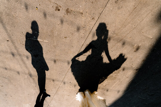 Shadow of unrecognizable woman dancing for man