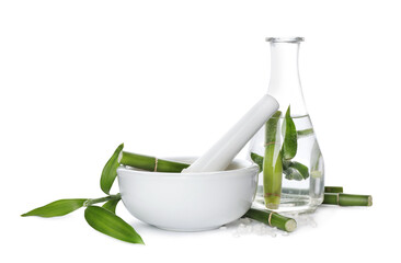 Composition with fresh bamboo and bath salt on white background. Spa procedure