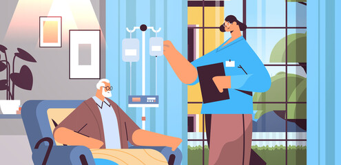 friendly nurse or volunteer checking dripper of elderly man patient home care services healthcare and social support - fototapety na wymiar