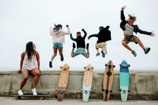 Kids jumping from seawall