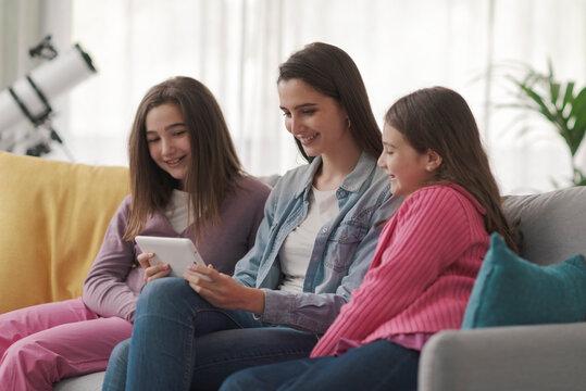 Girls watching videos online together