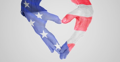 Composition of american stars and stripe flag decorated hands making heart shape over white