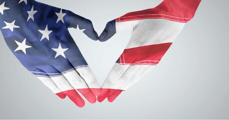 Composition of american stars and stripes flag decorated hands making heart shape over white