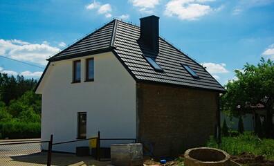 Fototapeta Dom w remoncie . Stary - nowy . Ostrowiec. House under renovation. Old - new. Ostrowiec . obraz