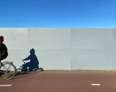 cyclist passing fence