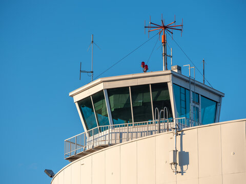 An exterior of an old and abandoned air traffic control tower from the 1930s'. VHF radio antennas on top of the roof.