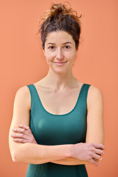 Slim smiling yoga instructor.