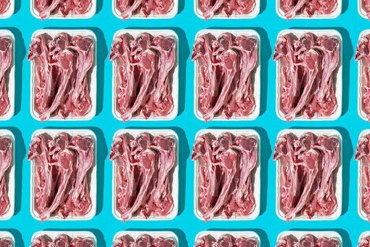 mosaic of raw lamb rib chops in foam trays