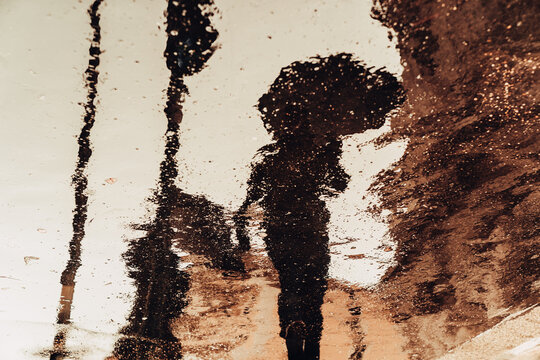 Silhouette of a man with an umbrella.