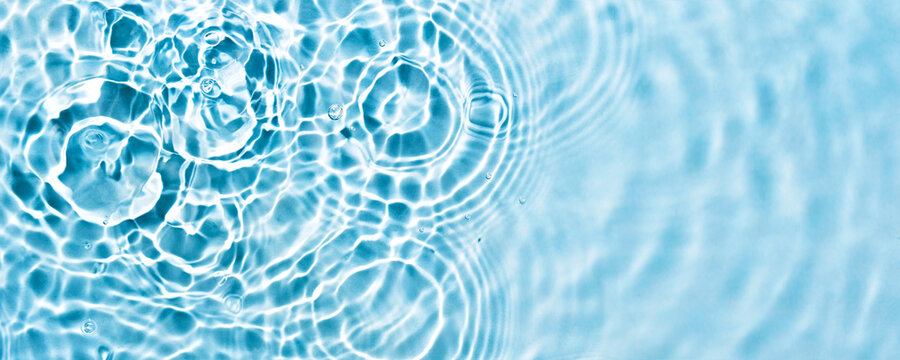 Abstract transparent liquid banner with concentric circles and ripples. Spa concept. Soft focus