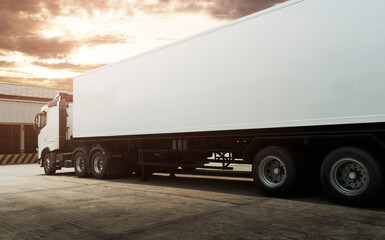 White Trailer Truck Parking at The Warehouse. Semi Truck. Road Freight Transportation and Logistics.