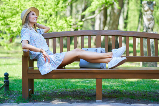 A nice happy girl sitting on a bench