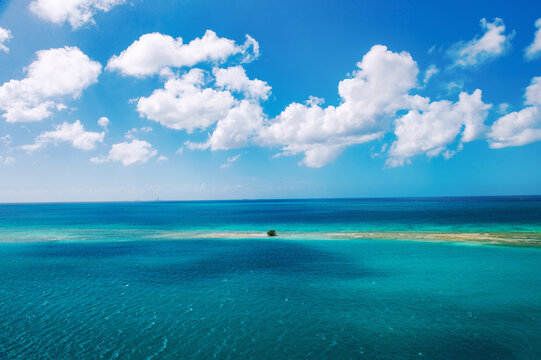 Beautiful turquoise sea perfect blue sky white clouds