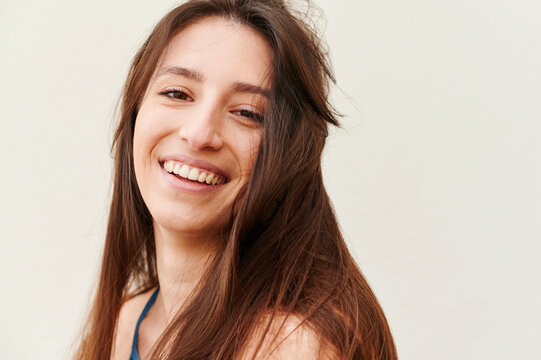 Carefree young woman laughing outside