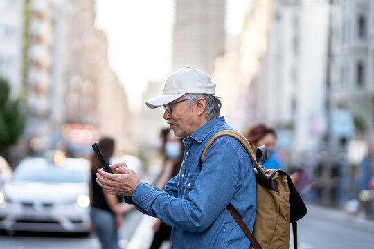 Happy Senior Asian Man in the City