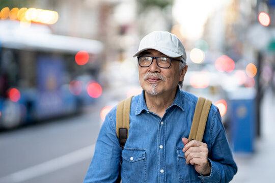Happy Asian Man Exploring the City