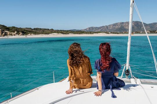 Women relaxing on catamaran deck