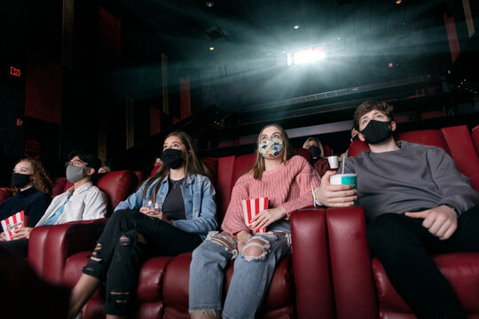 Movies: Young Adults Watching Movie During Covid