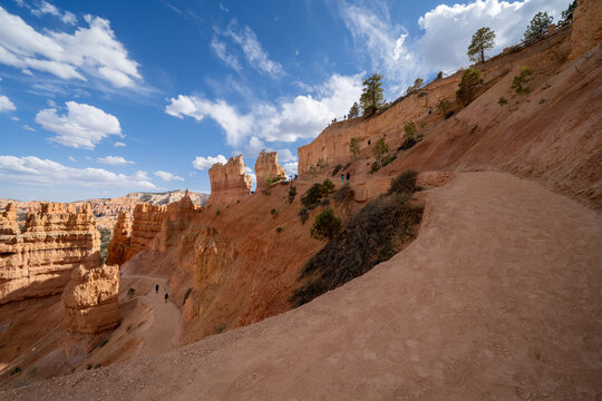 Scenery along the Queens Garden Navajo Loop Trail in Bryce Canyon Natiional Park Utah, unidentifiable hikers on trail