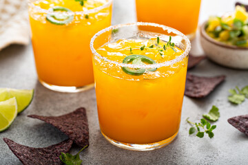 Pineapple and mango margarita with chips and guacamole
