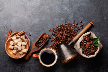 Roasted coffee beans, Turkish jezve, coffee cup and sugar