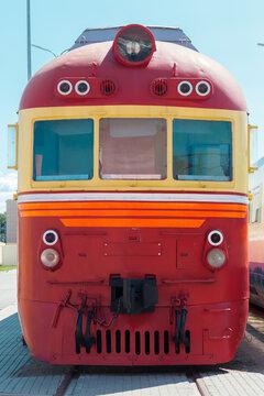 Vintage red diesel locomotive is on a railway