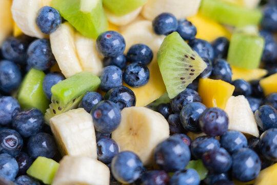 Fruit salad with fresh blueberries, bananas, kiwi and mango
