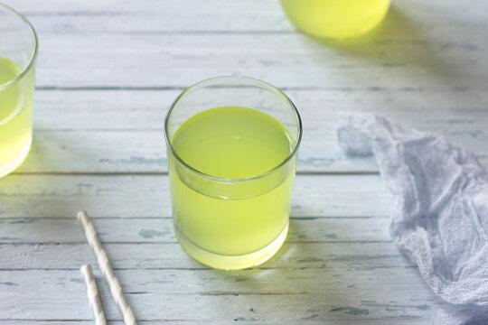 Healthy dietary milk whey in glasses bottle on light blue table