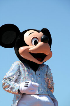 Mickey Mouse. Walt Disney character in a Disneyland parade. Disney World. Mickey in evening dress. Person disguised as Mickey in formal dress. The magic of Disney. Euro Disney. Disney Land Paris.