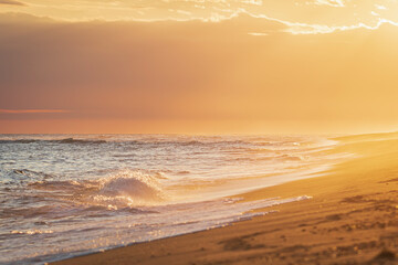 Mesmerizing view of a sandy beach at sunset
